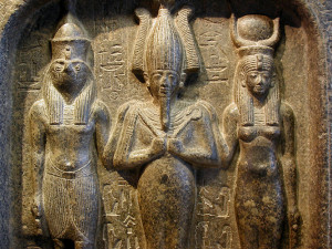 "The Egyptian ""trinity"" of Horus (the hawk-headed god of the sky, personification of the living Pharaoh), Osiris (the dead god of the underworld, personification of the mummified and dead Pharaohs), and Isis (the protector goddess). In order - son, husband, wife."